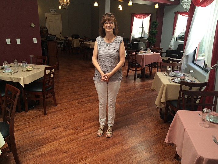 Gidgette Moshier stands inside her freshly opened business called English Garden Tea Room.