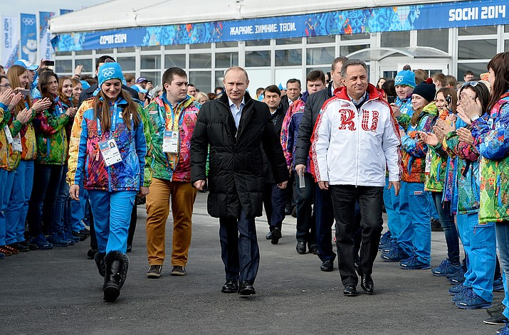 In this Feb. 5, 2014 file photo Russian President Vladimir Putin, center, visits the Olympic Athletes Village in Coastal Cluster ahead of the Sochi 2014 Winter Olympics with Olympic Village Mayor Elena Isinbaeva, left, and Russian Minister of Sport, Tourism and Youth policy Vitaly Mutko in Sochi, Russia. On Monday, July 18, 2016, WADA investigator Richard McLaren confirmed claims of state-run doping in Russia.