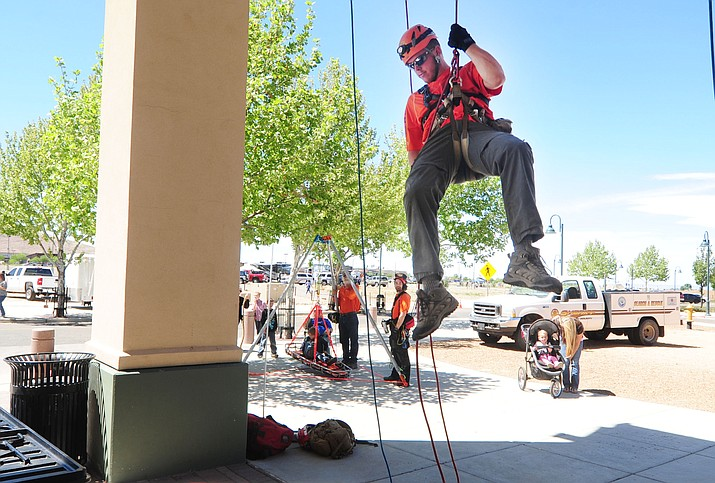 YCSO Search and Rescue's Dan Hughart  lowers himself from the second floor of the Prescott Valley Event Center as part of the displays from first responders at the Salute to Heroes event Sunday, April 24, 2016.