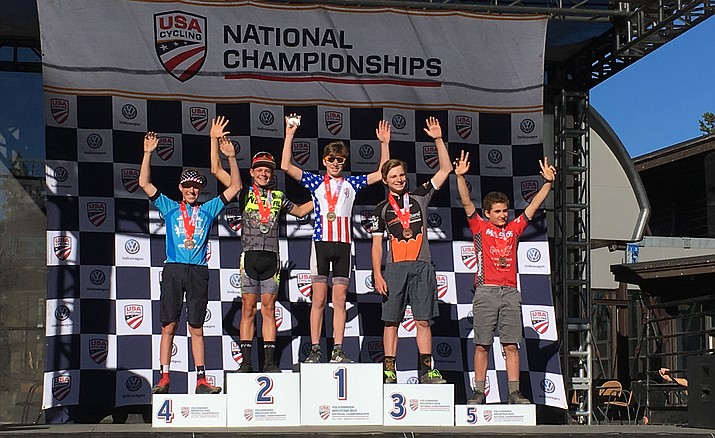 Hayden Rosborough, middle, receives the gold medal for winning the 13-14 age division of the cross-country race at the USA Cycling Mountain Bike National Championships.