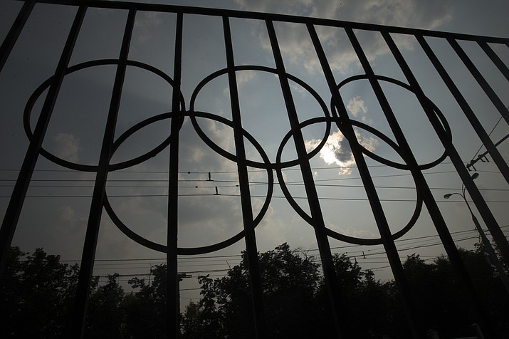 The Olympics rings are seen on a fence in front of the Russian Olympic Committee building in Moscow, Russia, Sunday, July 24. The IOC has decided against a complete ban on Russian athletes from the Olympics in Rio de Janeiro. The International Olympic Committee says it is leaving it up to global federations to decide which Russian athletes to accept in their sports.