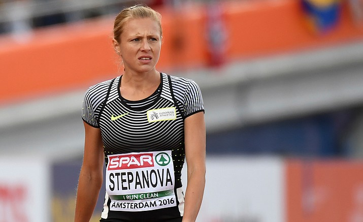 In this July 6, 2015 file photo Russian doping whistleblower Yuliya Stepanova who ran under a neutral flag leaves the track after suffering an injury in a women's 800m heat during the European Athletics Championships in Amsterdam, the Netherlands. The IOC said Sunday, July 24, 800-meter Yulia Stepanova, who along with her husband provided evidence of widespread doping in Russian track and field, could not race in Rio because she once served a doping ban.