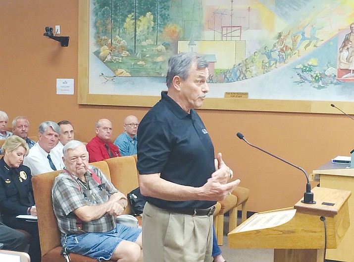 Chuck Abbott of Abbott Insurance urges the Prescott City Council to take existing insurance certification standards into consideration while considering a city ordinance that would impose new regulations on local structured sober-living homes.