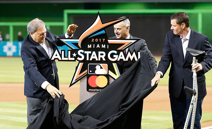 Jeffrey Loria, left, owner of the Miami Marlins, Robert Manfred Jr., commissioner of baseball, and Jeff Conine, special assistant to the president of the Marlins, unveil the official logo for the 2017 All-Star Game that will be held in Miami, during a ceremony before the start of a game between the Miami Marlins and the Philadelphia Phillies, Wednesday, July 27.