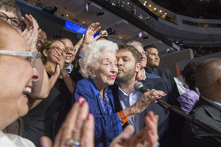 State Delegate Rep. Ruben Gallego kisses Jerry Emmett, 102, of Prescott, Arizona, center, on the cheek during an Arizona state delegation roll call at the Democratic National Convention in Philadelphia Tuesday, July 26. Emmett was born before women gained the right to vote in America, so it's fitting she announced that the Arizona delegation was casting 51 of its 85 votes for Hillary Clinton for president.