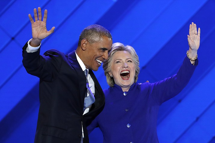President Barack Obama and Democratic Presidential nominee Hillary Clinton wave to delegates after President Obama's speech during the third day of the Democratic National Convention in Philadelphia , Wednesday, July 27, 2016.