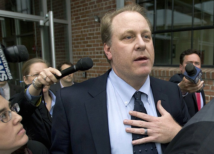 In this May 16, 2012, file photo, former Arizona Diamondbacks pitcher Curt Schilling is followed by members of the media as he departs the Rhode Island Economic Development Corporation headquarters, in Providence, R.I.