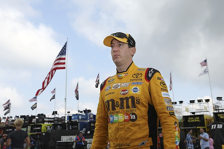 Kyle Busch (18) walks in the garage area at Pocono Raceway during practice for Sunday's NASCAR Sprint Cup Series Pennsylvania 400 auto race Sunday Friday, July 29, 2016, in Long Pond, Pa.