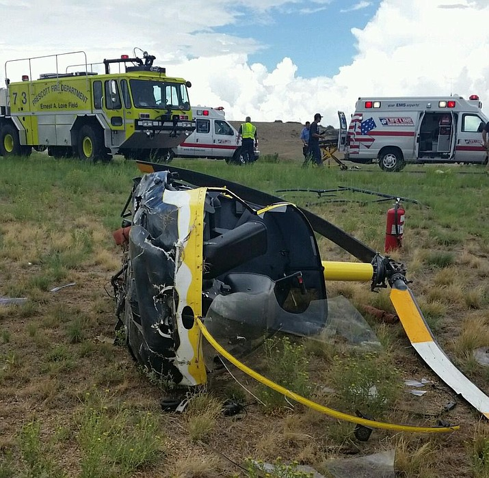 Two males were injured when this helicopter crashed Tuesday, Aug. 2, at the Prescott airport.