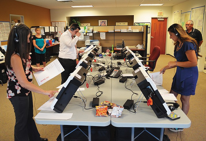 Representatives from the Arizona Secretary of State's Office test touch screen voting machines for sight, sound and functionality Friday in the Mohave County Elections Department office.