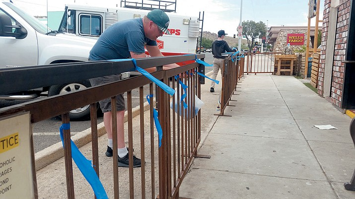 Robert Walker and his son, Xeth, tie ribbons to a fence on Beale Street as part of the 'Back the Blue' team.