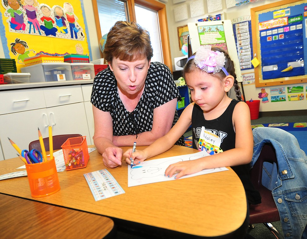 Kindergarten teacher Jana Murphy helps Haley Rivero on the first day of the 2016-17 school year at Abia Judd Elementary School in Prescott Thursday morning. (Les Stukenberg/The Daily Courier)