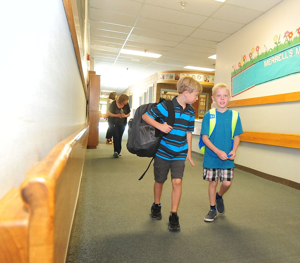 Second graders Chase Stedman and Blake Lawler hed to class during the first day of the 2016-17 school year at Abia Judd Elementary School in Prescott Thursday morning. (Les Stukenberg/The Daily Courier)