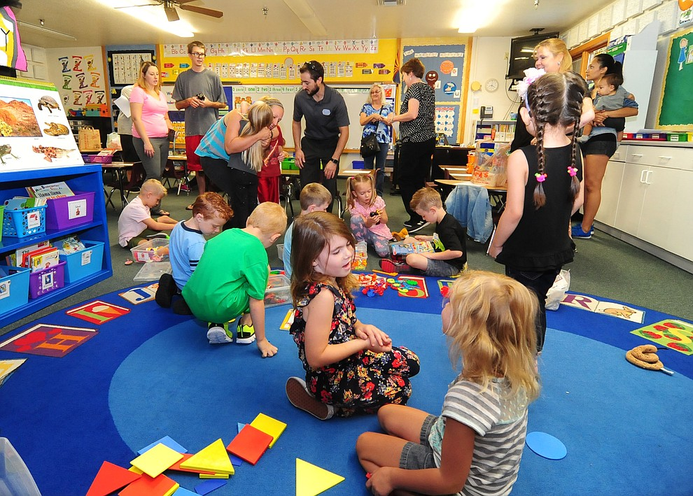Children play while parents say goodbye during the first day of the 2016-17 school year at Abia Judd Elementary School in Prescott Thursday morning. (Les Stukenberg/The Daily Courier)