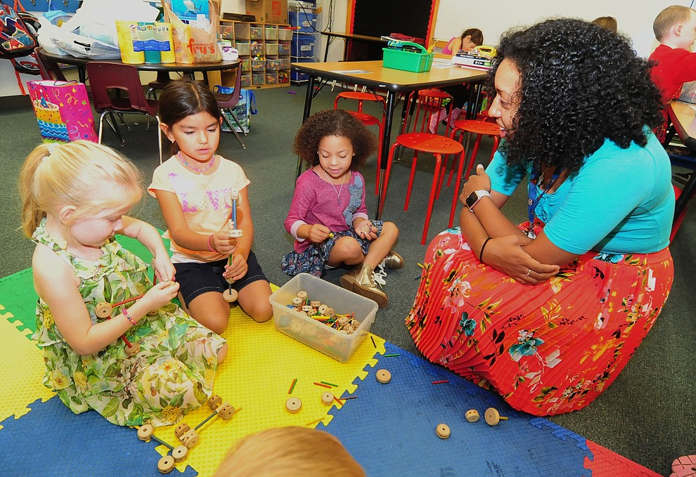 Kindergarten teacher Rachel Chunglo checks on three of her new students during the first day of the 2016-17 school year at Abia Judd Elementary School. One of Sen. Karen Fann's bills this Legislation session calls for making kindergarten an official grade.