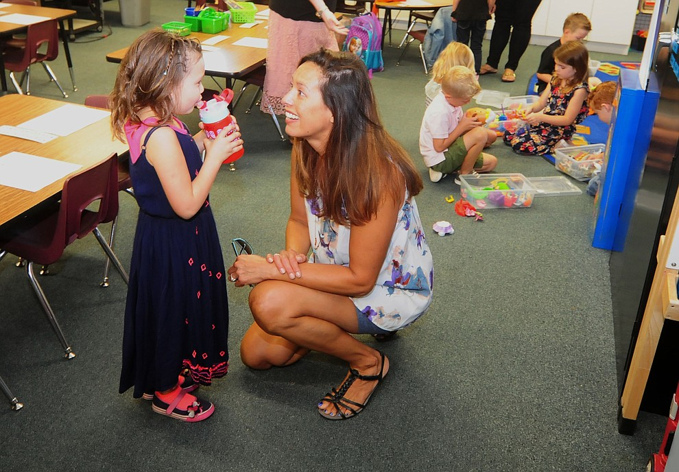 Kristin Pifer says goodbye to her daughter Ellas during the first day of the 2016-17 school year at Abia Judd Elementary School in Prescott Thursday morning. (Les Stukenberg/The Daily Courier)