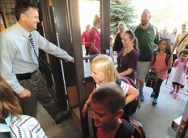 Principal Clark Tenney opens the doors for the first day of the 2016-17 school year at Abia Judd Elementary School in Prescott Thursday morning, Aug. 4.