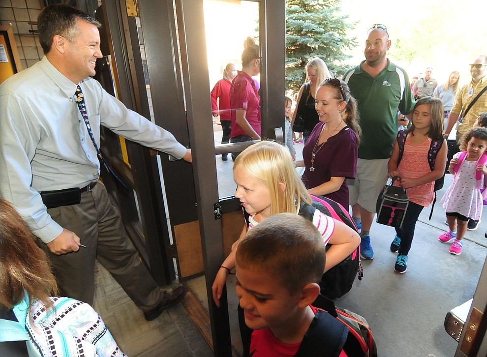 Principal Clark Tenney opens the doors for the first day of the 2016-17 school year at Abia Judd Elementary School in Prescott Thursday morning. (Les Stukenberg/The Daily Courier)