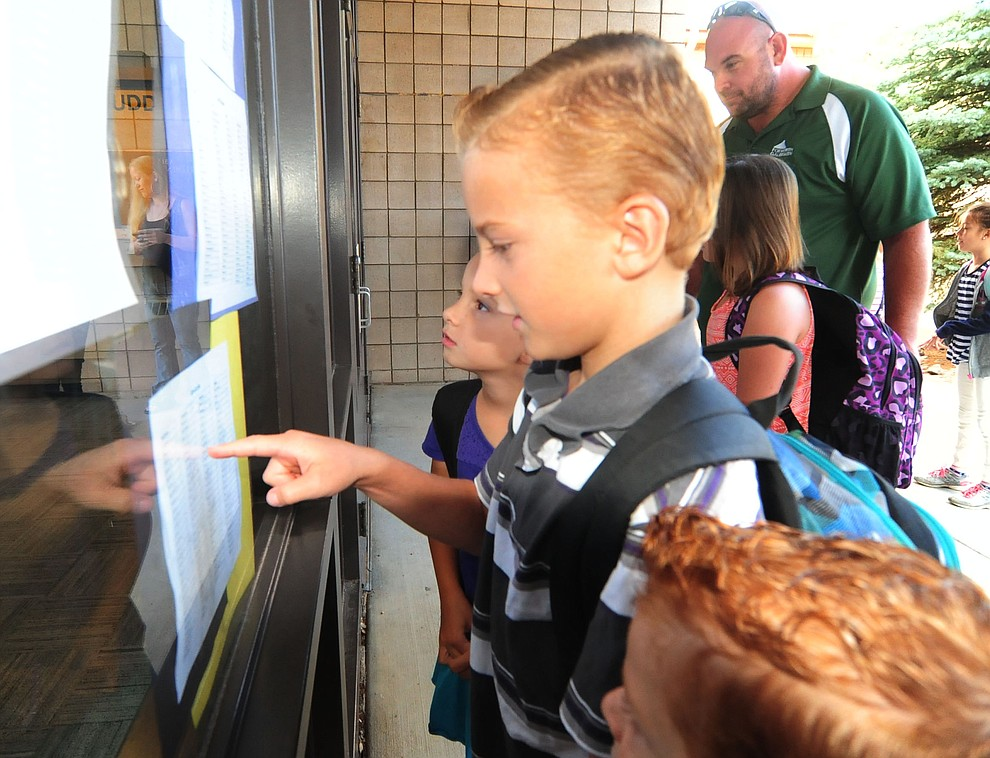 Fourth grader Kaden Daniels checks who is in his class during the first day of the 2016-17 school year at Abia Judd Elementary School in Prescott Thursday morning. (Les Stukenberg/The Daily Courier)