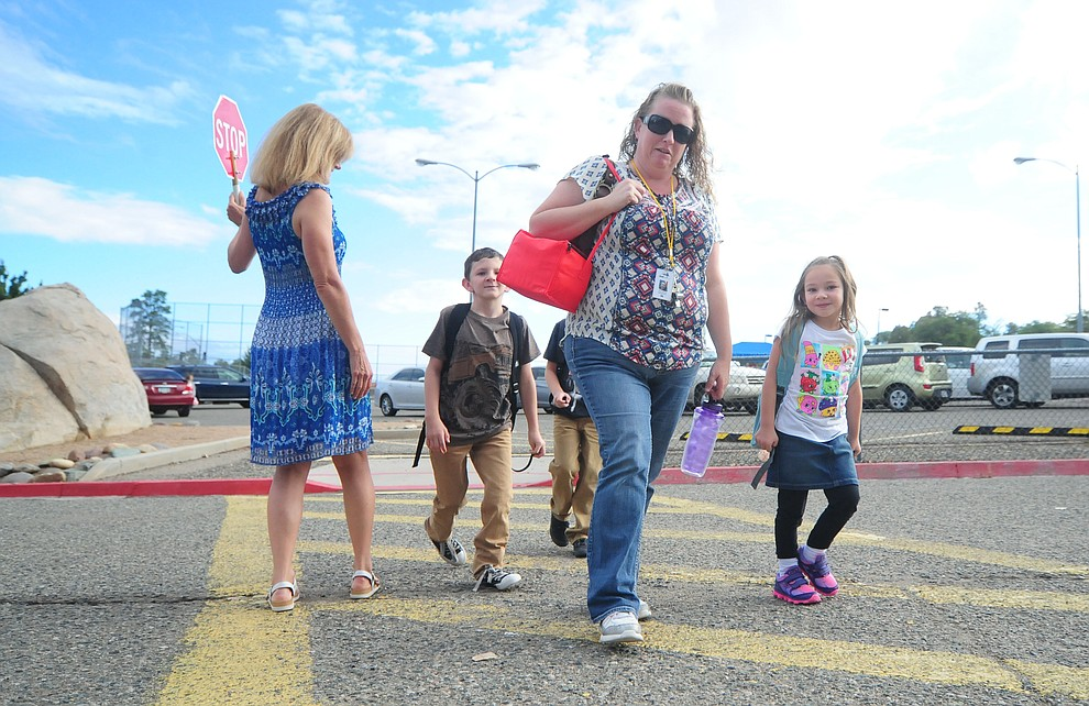 The Mantooth family heads to the first day of the 2016-17 school year at Abia Judd Elementary School in Prescott Thursday morning. (Les Stukenberg/The Daily Courier)