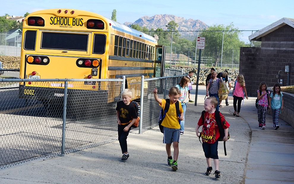 Students head off the bus and to class during the first day of the 2016-17 school year at Abia Judd Elementary School in Prescott Thursday morning. (Les Stukenberg/The Daily Courier)