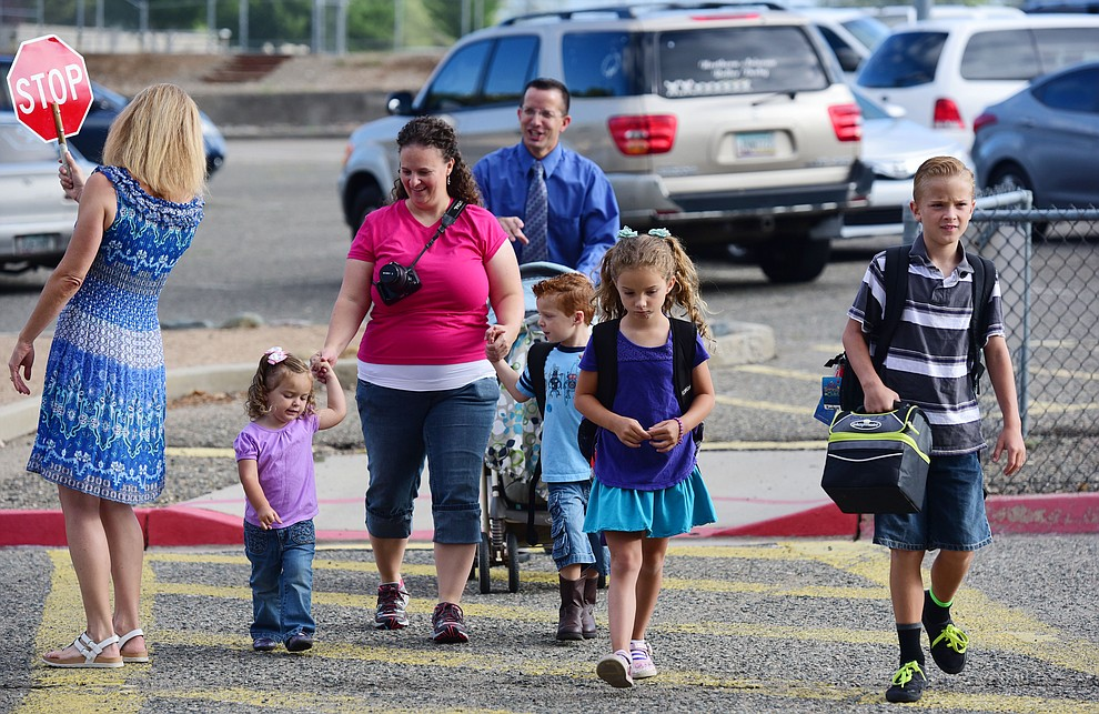 The Damiels family heads to the first day of the 2016-17 school year at Abia Judd Elementary School in Prescott Thursday morning. (Les Stukenberg/The Daily Courier)