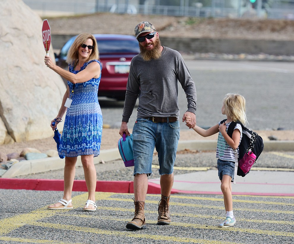 Teacher Melissa Scott greets Randy and kindergartener Layla Penning on the first day of the 2016-17 school year at Abia Judd Elementary School in Prescott Thursday morning. (Les Stukenberg/The Daily Courier)