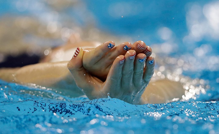 United States' Missy Franklin, with her nails painted the colors of the United States flag, swims during a training session at the 2016 Summer Olympics, Thursday, Aug. 4, in Rio de Janeiro, Brazil.