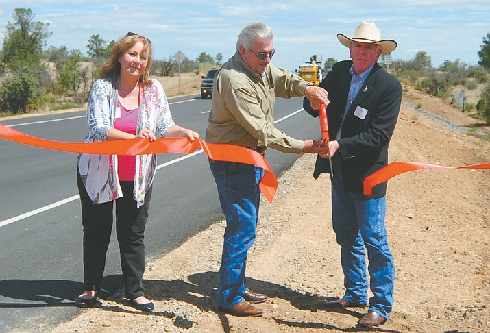 State Transportation Board Vice Chair Deanna Beaver, County Supervisor Craig Brown and Prescott Mayor Harry Oberg cut the ribbon Thursday for the new Willow Creek Road realignment.