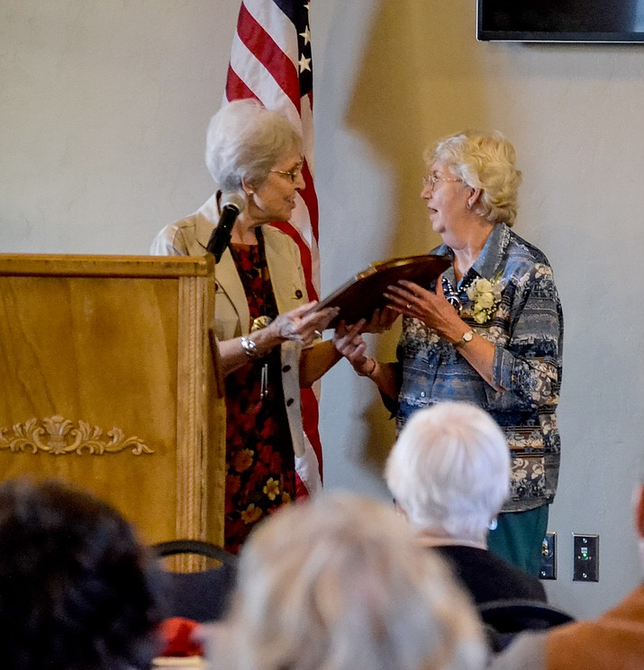 "Reba Grandrud, left, presents the Sharlot Hall Award to Sylvia Neely during the 2015 Western History Symposium. This year's symposium will feature presentation of the annual award to Winifred ""Winn"" Bundy, owner of the Singing Wind Bookshop in Benson, for her wide-ranging work as a historian and literary preservationist."
