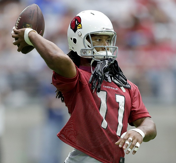 Arizona Cardinals' Larry Fitzgerald throws the ball during practice at the NFL football team's training camp, Friday, July 29, 2016, in Glendale, Ariz.