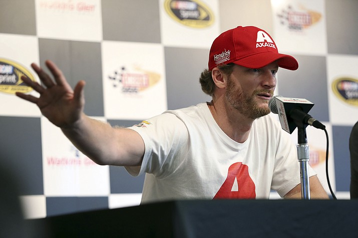 Dale Earnhardt Jr. answers a question about his concussion while addressing the media at Watkins Glen International racetrack during practice for Sunday's NASCAR Sprint Cup Series auto race Friday, Aug. 5, 2016, in Watkins Glen, N.Y. Jeff Gordon came out of retirement to fill in for the injured Dale Earnhardt Jr.
