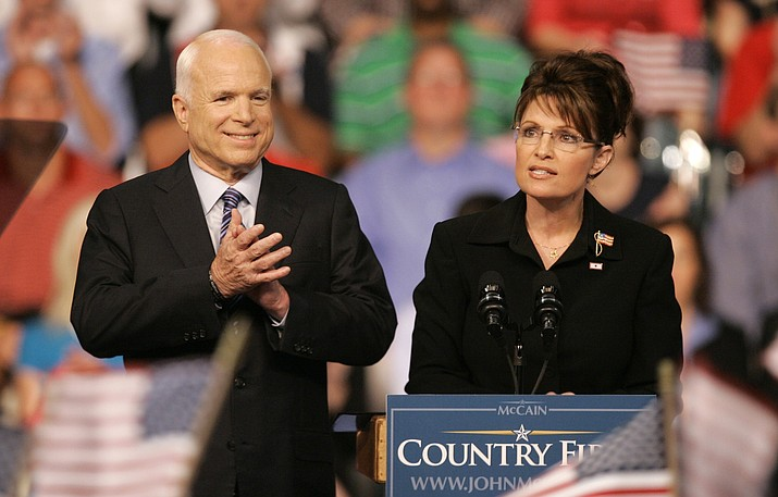 In this Aug. 29, 2008, file photo, Republican Alaska Gov. Sarah Palin, right, delivers a speech as Republican presidential candidate, Sen. John McCain, R-Ariz., introduces her as his vice presidential running mate at Wright State University's Ervin J. Nutter Center in Dayton, Ohio. Eight years after stumping across the nation as the Republican Party's presidential candidate, McCain is back on the campaign trail in his home state as he faces a primary challenge and a strong Democratic opponent, State Sen. Kelli Ward, in the general election.