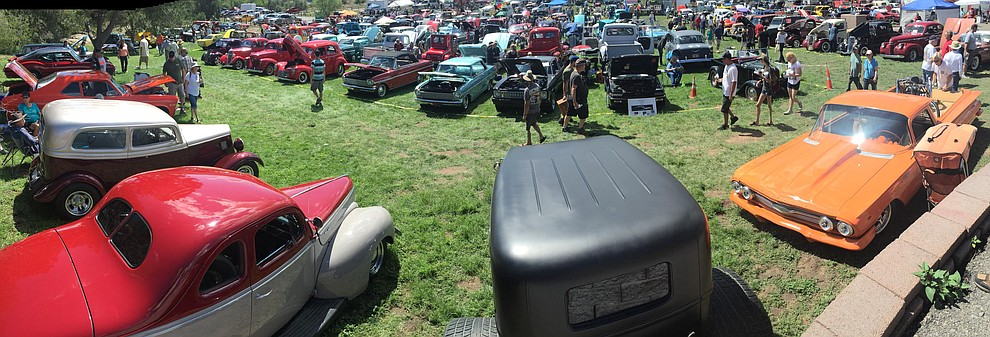 People take in the hundreds of cars, trucks, and parts vendors at the 42nd Annual Prescott Antique Auto Club show at Watson Lake Park Saturday. The show continues all day on Sunday.