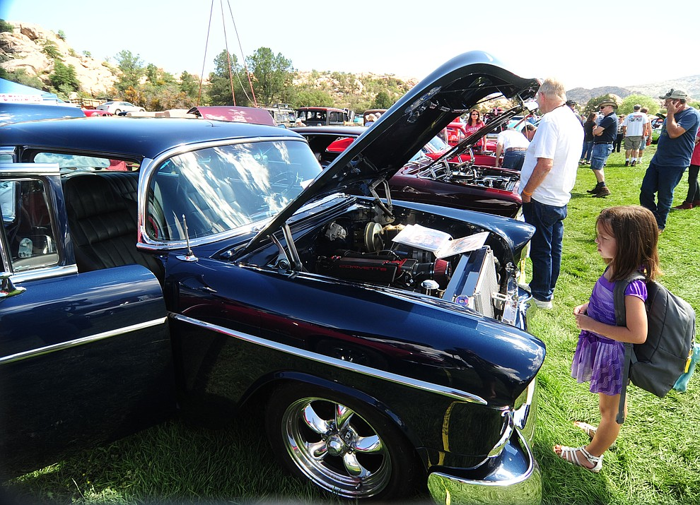 Young and old alike take in the hundreds of cars, trucks, and parts vendors at the 42nd Annual Prescott Antique Auto Club show at Watson Lake Park Saturday. The show continues all day on Sunday.  (Les Stukenberg/The Daily Courier)