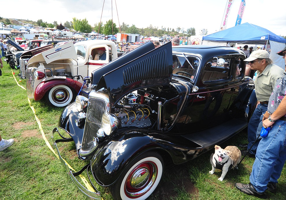 People get an upclose look at the hundreds of cars, trucks, and parts vendors at the 42nd Annual Prescott Antique Auto Club show at Watson Lake Park Saturday. The show continues all day on Sunday.  (Les Stukenberg/The Daily Courier)