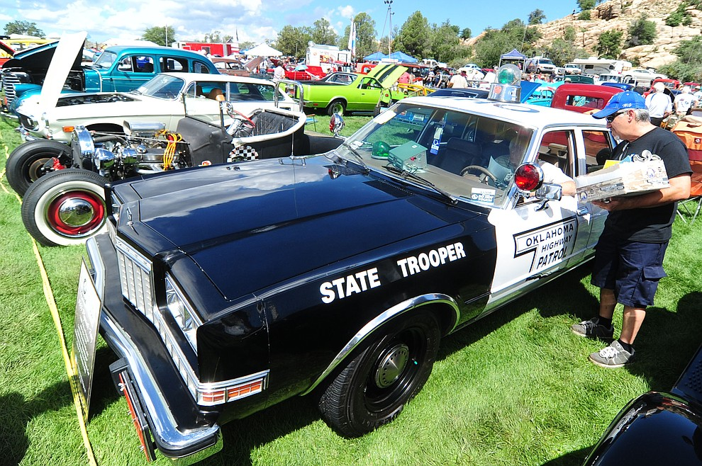 A restored Oklahome State Trooper car was one of hundreds of cars, trucks, and parts vendors at the 42nd Annual Prescott Antique Auto Club show at Watson Lake Park Saturday. The show continues all day on Sunday.  (Les Stukenberg/The Daily Courier)