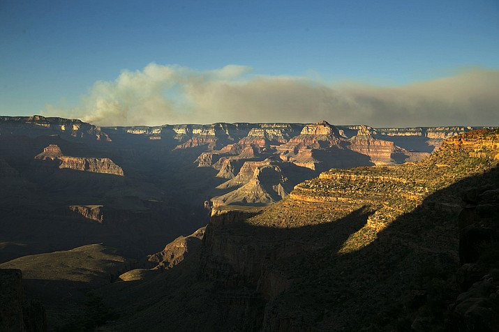 A wildfire burns on the north rim of the Grand Canyon as seen from the Bright Angel Trail below the south rim of the canyon in Grand Canyon National Park in Arizona, Thursday, July 14, 2016.