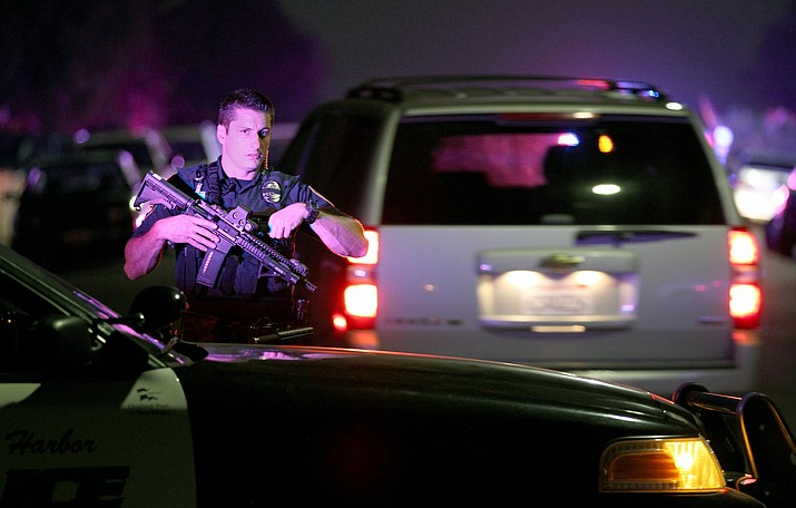In this Thursday night, July 28, 2016, file photo, a San Diego Harbor Police officer helps to secure the scene in San Diego near where two San Diego Police officers were shot Thursday night. The critical moment when a gunman opened fire on two San Diego police officers, killing one, wasn't captured on the camera one of the officers was wearing because he didn't turn it on until after bullets flew. It's the latest example of the hole created by policies like San Diego's that allow officers to determine when to start recording.
