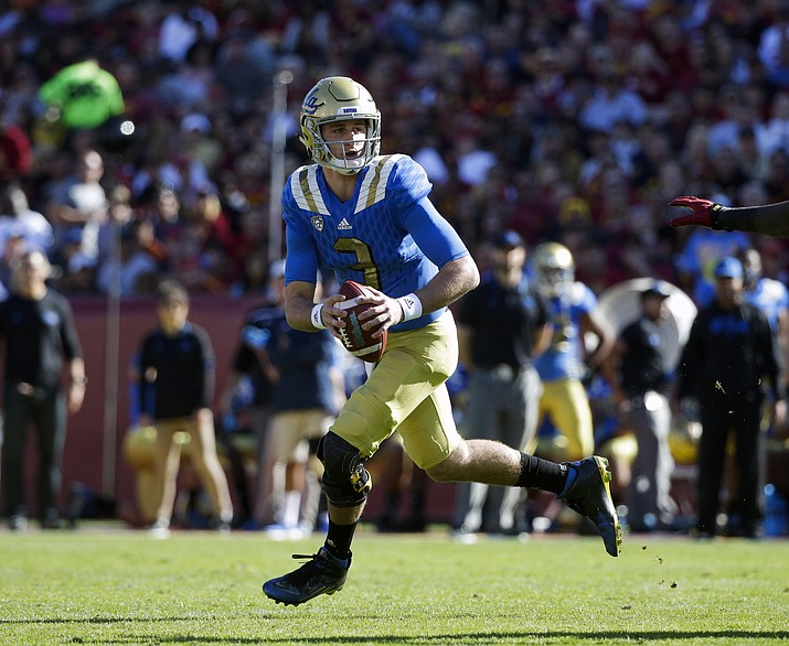 In this Nov. 28, 2015, file photo, UCLA quarterback Josh Rosen looks for a receiver during the first half of an NCAA college football game against Southern California, in Los Angeles. A new offensive scheme should mean bigger plays and more chances for Chosen Rosen to shine.