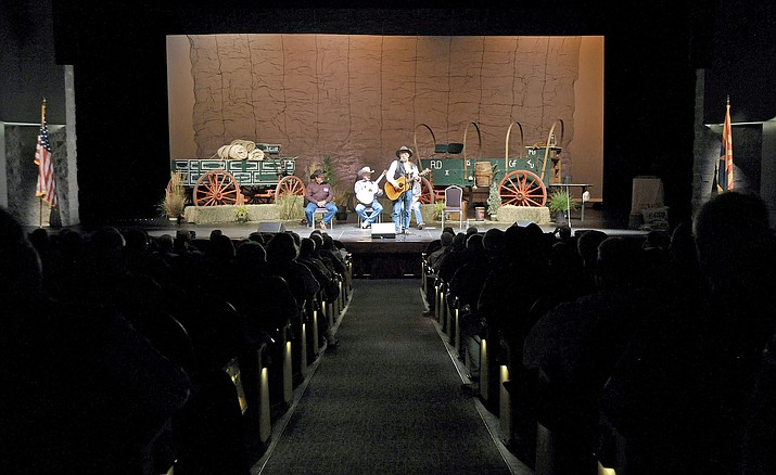 "People fill the Yavapai College Performance Hall for a session titled ""Working Hands"" by Jay Snider, Dale Burson, and Hannah and Randy Huston, during the 2015 Cowboy Poets Gathering. This year's 29th annual event will span three days, Aug. 11-13, at Yavapai College."