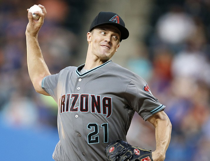 Arizona Diamondbacks starting pitcher Zack Greinke (21) winds up during the first inning of a baseball game against the New York Mets, Tuesday, Aug. 9, 2016, in New York.