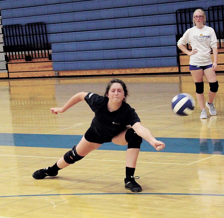 Morgan Stephens lunges for a dig during KHS Lady Bulldog volleyball tryouts,.
