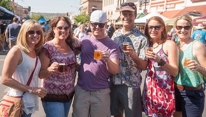 Beer tasters having a great time at last year's Mile High Brewfest in Prescott.