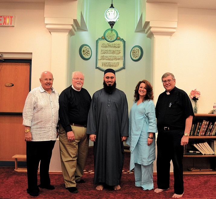 From left, Ray Christenson, Grace Lutheran Church; Father Phillip Shaw, Trinity Episcopal Church; Umar Farooq Mahmood, Masjid-E-Ibrahim Mosque; Rabbi Mindie Snyder,Temple of the Pines Synagogue in Flagstaff; and Father Leonard Walker, of the Divine Savior Independent Catholic Community.
