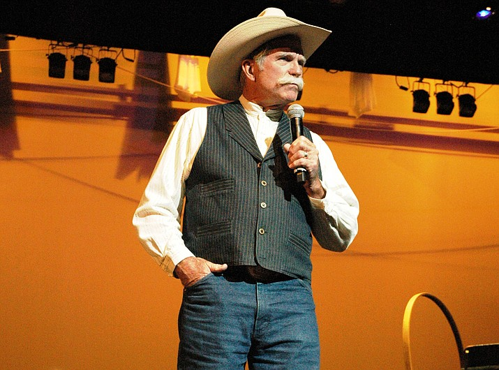 Dale Page performs poetry during the 29th annual Arizona Cowboy Poets Gathering in Prescott at the Yavapai College Performing Arts Center. (Courier, file)