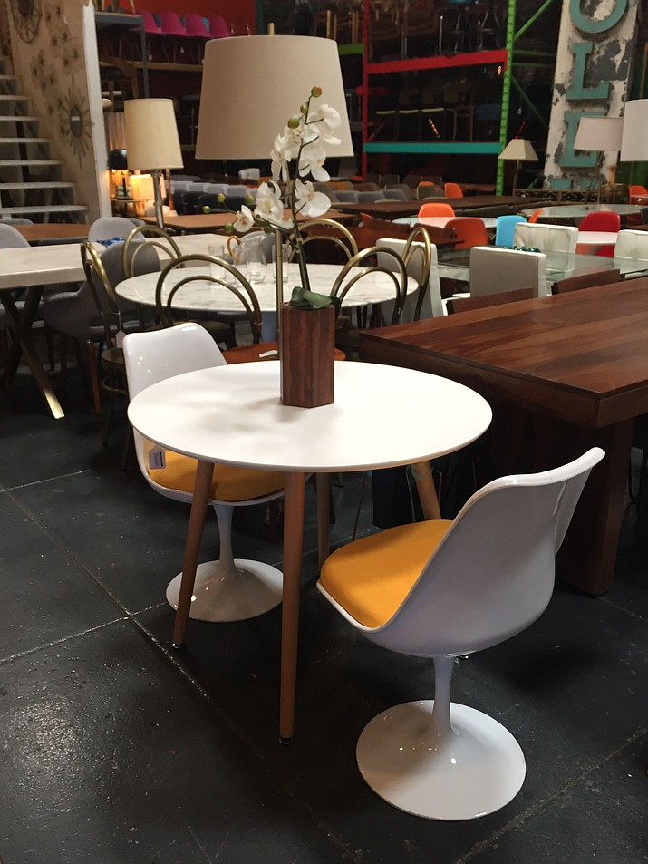 Dining room tables and chairs at Los Angeles store Sunbeam Vintage, which sells new, on-site handmade, imported and vintage furniture, and mostly specializes in mid-century modern and mid-century modern inspired pieces.