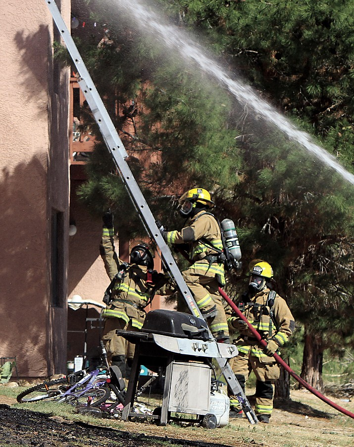 A Kingman Fire Department crew attacks the Copper Ridge Apartments fire on June 23.
