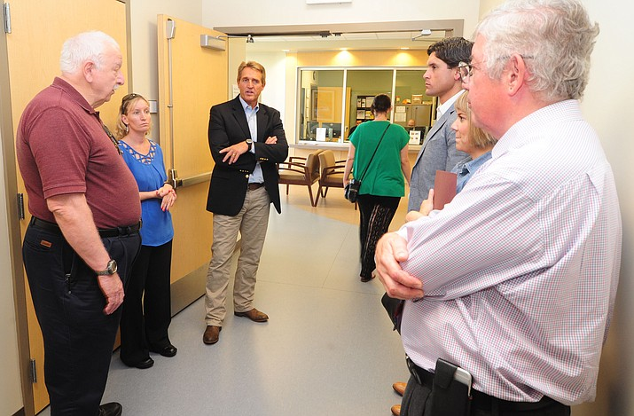 United States Senator Jeff Flake asks questions of the staff as he tours the new mental health facility at the Northern Arizona VA Hospital in Prescott Thursday afternoon. (Les Stukenberg/The Daily Courier)