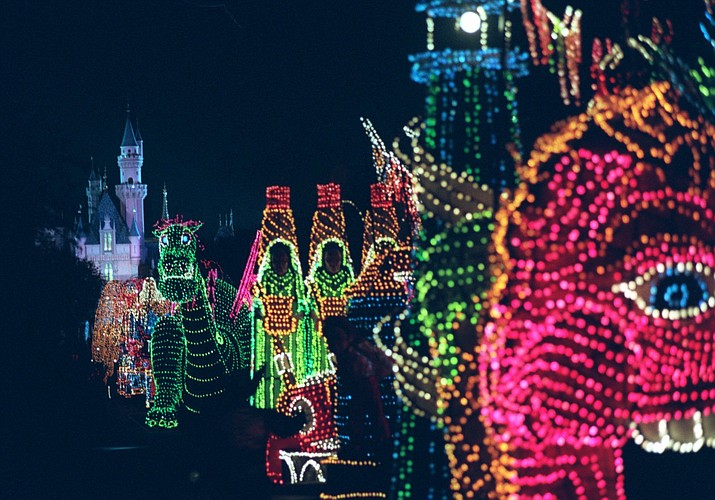 In this Nov. 25, 1996, file photo, the Main Street Electrical Parade moves down Main Street in Disneyland, in Anaheim, Calif., during its last night of performances. Disney says the parade will return to Disneyland for a limited run after it ends its run at Walt Disney World in Florida on October 9.